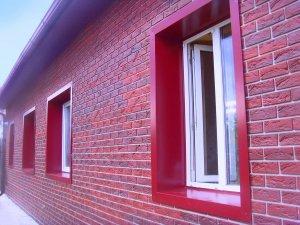 Как обшить дом фасадными панелями